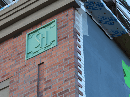 Buiding Protected with Old Mill Brick's Air + Water Barrier with Modified Adhesive